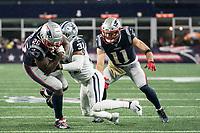 FOXBOROUGH, MA - NOVEMBER 24: Dallas Cowboys Cornerback Byron Jones #31 tackles New England Patriots Runningback Sony Michel #26 during a game between Dallas Cowboys and New England Patriots at Gillettes on November 24, 2019 in Foxborough, Massachusetts.