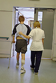 Physiotherapist and patient in the Spinal Injuries Department at the Royal National Orthopaedic Hospital, Stanmore