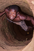Tortiya, Ivory Coast (Cote d'Ivoire).  Diamond Miner Looking up from his Shaft.