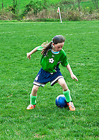 Young girl in a youth soccer game.