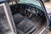 BNPS.co.uk (01202 558833)<br /> Pic: SilverstoneAuctions/BNPS<br /> <br /> Pictured: The interior of the 1964 Porsche 3560C.<br /> <br /> A classic Porsche has emerged for sale after it was discovered in storage exactly as it was left over four decades ago.<br /> <br /> The 1964 3560C coup with its original blue paintwork is remarkably rare as most of its kind were scrapped after they were superseded by the more popular 911 model.<br /> <br /> Found by the seller in a barn where it languished since it was last driven in 1977, the car is a time capsule full of historic items left untouched for decades.