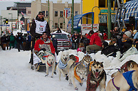 2010 Iditarod Ceremonial Start in Anchorage Alaska musher # 10 JUSTIN SAVIDIS with Iditarider BARTON BLACKBURN