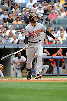 Baltimore Orioles outfielder Nick Markakis #21 hits a home run during game against the New York Yankees at Yankee Stadium on September 5, 2011 in Bronx, NY.  Yankees defeated Orioles 11-10.  Tomasso DeRosa/Four Seam Images