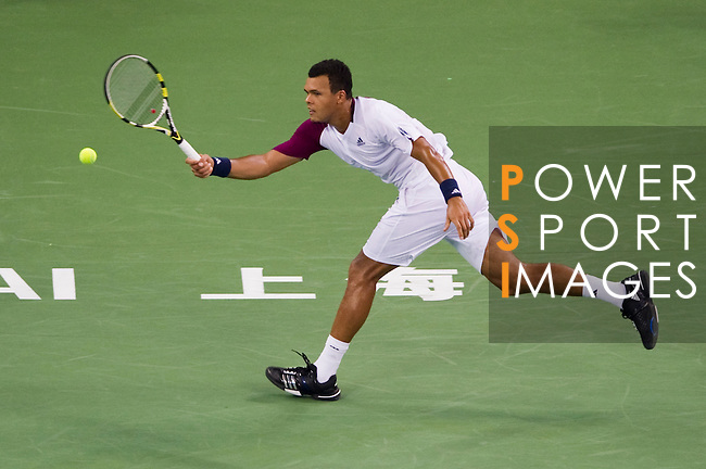 SHANGHAI, CHINA - OCTOBER 14:  Jo-Wilfried Tsonga of France returns a bal to Florian Mayer of Germany during day four of the 2010 Shanghai Rolex Masters at the Shanghai Qi Zhong Tennis Center on October 14, 2010 in Shanghai, China.  (Photo by Victor Fraile/The Power of Sport Images) *** Local Caption *** Jo-Wilfried Tsonga