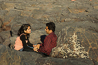 "A young Indian couple. The fort area in Mumbai is very popular with young people, ""lovers Lane or better better called beach"", every afternoon, getting away from trafic and the city"
