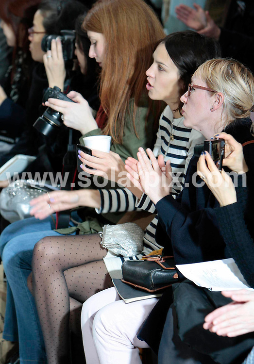 **ALL ROUND PICTURES FROM SOLARPIX.COM**                                             **NO UK NEWSPAPER PUBLICATION**.**UK MAGAZINE & SUPPLEMENT PUBLICATION ONLY** AND NO PUBLICATION IN AUSTRALIA, BELGIUM, FRANCE, GERMANY, ITALY, SCANDINAVIA AND USA**                                                                                  Caption:  The Margaret Howell catwalk                                                     Collection 2011 at Somerset House in London, UK                                                                    This pic:  Alex Chung enjoys a coffee as she films the Margaret Howell catwalk                                                                                          JOB REF:12842       SFE       DATE:19.02.2011                                                            **MUST CREDIT SOLARPIX.COM OR DOUBLE FEE WILL BE CHARGED**                                                                      **MUST AGREE FEE BEFORE ONLINE USAGE**                               **CALL US ON: +34 952 811 768 or LOW RATE FROM UK 0844 617 7637**