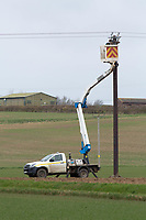 16.3.2021 Electricity cable teams working on overhead power cables crossing farmland <br /> ©Tim Scrivener Photographer 07850 303986<br />      ....Covering Agriculture In The UK....