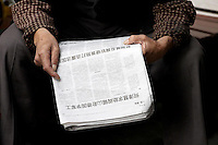 A man reading a Chinese newspaper.<br /> <br /> To license this image, please contact the National Geographic Creative Collection:<br /> <br /> Image ID: 2169181  <br /> <br /> Email: natgeocreative@ngs.org<br /> <br /> Telephone: 202 857 7537 / Toll Free 800 434 2244<br /> <br /> National Geographic Creative<br /> 1145 17th St NW, Washington DC 20036