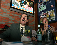 Quebec City, March 27 2007 ? Chauveau ADQ candidate Gilles Taillon and his wife reacts to result giving the ADQ in good position in the 2007 Quebec provincial March 27, 2007.  The Quebec City area ADQ supporters rallied at a local Cage Aux Sports restaurant to fellow the election night<br /> <br /> PHOTO :  Francis Vachon - Agence Quebec Presse