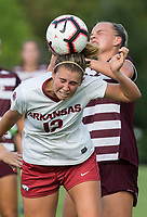 Hawgs Illustrated/BEN GOFF <br /> Kayla McKeon (12) of Arkansas wins a header vs Grace Piper of Texas A&M in the first half Thursday, Sept. 20, 2018, at Razorback Field in Fayetteville.