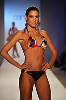 MIAMI, FL - JULY 21:  A model walks the runway at the Caffe Swimwear show during Mercedes-Benz Fashion Week Swim 2014 at Oasis at the Raleigh on July 21, 2013 in Miami, Florida.<br />
