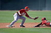 Cincinnati Reds infielder Zach Vincej (39) tags out Sergio Alcantara (1) sliding in during an Instructional League game against the Arizona Diamondbacks on October 5, 2013 at Salt River Fields at Talking Stick in Scottsdale, Arizona.  (Mike Janes/Four Seam Images)