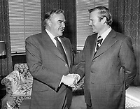 Switching the reins of power, former Ontario premier John Robarts (left) shakes hands with successor, Premier William Davis, at Queen's Park yesterday after Davis was sworn in by Lieutenant-Governor W. Ross Macdonald.<br /> <br /> Photo : Boris Spremo - Toronto Star archives - AQP