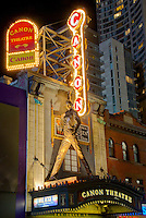 """Low-angle view of the marquee and facade of Canon Theatre, 263 Yonge St, Toronto, Ontario, Canada in July 2007. The statue of Freddie Mercury was erected for the 61-week run of the Queen musical """"We Will Rock You"""""""