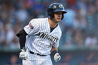 Eddy Alvarez (10) of the Charlotte Knights hustles down the first base line against the Toledo Mud Hens at BB&T BallPark on June 22, 2018 in Charlotte, North Carolina. The Mud Hens defeated the Knights 4-0.  (Brian Westerholt/Four Seam Images)