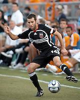 D.C. United midfielder Ben Olsen (14) settles the ball.  Houston Dynamo defeated D.C. United 1-0 at Robertson Stadium in Houston, TX on July 8, 2007.
