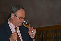 Jean-Philippe Moulin, Cellar Master or Chef de Cave, tasting one of the wines he has made, Champagne Ruinart, Reims, Champagne, Marne, Ardennes, France, low light grainy grain