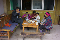 Diqing Tibetan Autonomous Prefecture, Yunnan Province, China - Members of a Tibetan family have traditional breakfast, August 2018.
