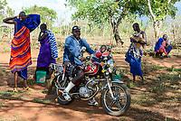 TANZANIA, Korogwe, Massai in Kwalukonge village, Massai warrior with chinese motorbike T-better produced by Fekon Motor Company  / TANSANIA, Korogwe, Massai im Dorf Kwalukonge, Massai Krieger mit chinesischem Motorrad T-Better hergestellt von Fekon Motor