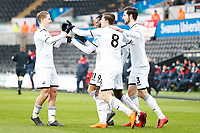 Sunday 18 March 2018<br /> Pictured:  Botti Biabi of Swansea City celebrates scoring his sides first goal of the match with George Byers and Matic Paljk and Adnan Maric<br /> Re: Swansea City v Manchester United U23s in the Premier League 2 at The Liberty Stadium on March 18, 2018 in Swansea, Wales.