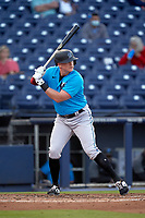 Miami Marlins Garrett Cooper (26) bats during a Major League Spring Training game against the Washington Nationals on March 20, 2021 at FITTEAM Ballpark of the Palm Beaches in Palm Beach, Florida.  (Mike Janes/Four Seam Images)