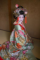 """Japan; Kyoto. Kikugawa, a Tayu or Oiran. Once known as a courtesans, they are highly educated in tea cermony, flower arranging, playing music, calligraphy, are well read and good conversationists. Her black teeth are a sign of beauty. Therare about 5 tayu today, compared to about 300 geisha. """"A tayu is my ideal woman image, I chose to be one. I was also concerned that this culture would disapear."""" Model released."""