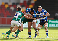 27th March 2021; Brentford Community Stadium, London, England; Gallagher Premiership Rugby, London Irish versus Bath; Anthony Watson of Bath is tackled by Ollie Hassell-Collins and Nick Phipps of London Irish