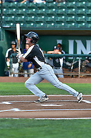 Tyler Bugner (11) of the Grand Junction Rockies follows through on his swing against the Ogden Raptors during the Pioneer League game at Lindquist Field on August 26, 2016 in Ogden, Utah. The Raptors defeated the Rockies 6-5. (Stephen Smith/Four Seam Images)