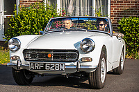 BNPS.co.uk (01202 558833)<br /> Pic: MaxWillcock/BNPS<br /> <br /> Pictured: David Townend and his son Michael in the MG Midget<br /> <br /> A dad who bought a run down sports car the year his first child was born has finished restoring it 27 years later - just in time for his son's wedding. <br /> <br /> David Townend, 60, bought the 1974 MG Midget in 1994 for almost £300. <br /> <br /> He kept the rusty motor in his garage with the intention of returning it to its former glory.<br /> <br /> But 'life got in the way' and the restoration project was put on the back burner.
