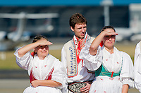 Young Czech girls and boys, wearing folk costume, wait for the arrival of the Pope Benedict XVI at the Prague Airport, Czech Republic, 26 September 2009.