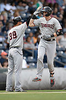 Sam Huff (25) of the Hickory Crawdads plants a leaping high-five on manager Matt Hagen after hitting his 12th home run of the season in a game against the Greenville Drive on Tuesday, April 30, 2019, at Fluor Field at the West End in Greenville, South Carolina. Hickory won, 5-4. (Tom Priddy/Four Seam Images)