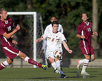 Boston College midfielder/defender Conor Fitzpatrick (8) clears the ball as Harvard University midfielder Tim Schmoll (19) closes. Boston College defeated Harvard University, 2-0, at Newton Campus Field, October 11, 2011.