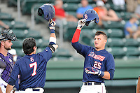 Left fielder Jordan Fucci (25) of the Samford Bulldogs is congratulated after hitting a home run against Furman in a SoCon Tournament game on Saturday, May 28, 2016, at Fluor Field at the West End in Greenville, South Carolina. (Tom Priddy/Four Seam Images)