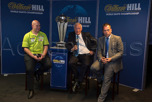 13.06.2014. London, England.  Rileys Sports Bar, Haymarket. The  launch of William Hill's sponsorship as title sponsor of the 2015 World Darts Championship. Reigning World Darts Champion Michael van Gerwen [L], PDC Chairman Barry Hearn and William Hill Chief Marketing Officer Kristof Fahy [R].