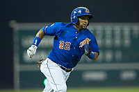 Emilio Bonifacio (22) of the Durham Bulls hustles towards home plate against the Louisville Bats at Durham Bulls Athletic Park on May 28, 2019 in Durham, North Carolina. The Bulls defeated the Bats 18-3. (Brian Westerholt/Four Seam Images)