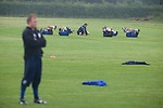 Stockport Pre-Season Training, 09/07/2008. Manor Farm, Timperley, League One. Stockport County goalkeepers doing stretching exercises during a pre-season training session at the club's training ground at Manor Farm, Timperley, Cheshire. Stockport County were promoted up to league One following a play-off final victory over Rochdale at Wembley in May, 2008. Jim Gannon took over as manager of the club in 2006 and lead them to promotion after three seasons in League Two. Photo by Colin McPherson.