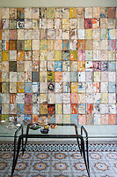 """On the opposite wall of the living room is another Damian Aquiles piece from the series """"Building my Silence"""" for which metal from paint cans has been stretched and nailed to wooden frames and assembled to form a mosaic"""