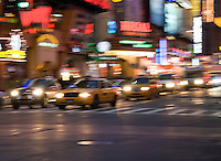 AVAILABLE FROM GETTY IMAGES FOR LICENSING.  Please go to www.gettyimages.com and search for image # 141112707.<br /> <br /> Traffic on 42nd Street Near Times Square at Dusk, Midtown Manhattan, New York City, New York State, USA
