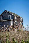Shoreline shingled New England traditional house.