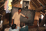 Marsh Arabs. Southern Iraq.  Marsh Arab children in school building. Traditional reed constructed building. Portrait of Saddam Hussein hanging from wall. Haur al Mamar or Haur al-Hamar marsh collectively known now as Hammar marshes Iraq 1984