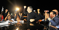 Tunisia's presidential candidate Nabil Karoui greets his supporters after being released from Mornaguia prison near the capital Tunis on October 9, 2019,