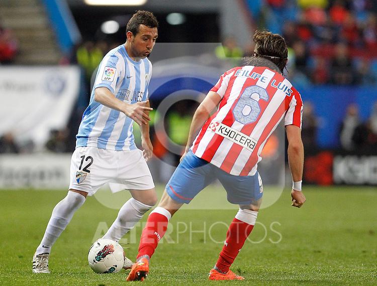 Atletico de Madrid's Filipe Luis (r) and Malaga's Santiago Cazorla during La Liga match. Mayo 5,2012. (ALTERPHOTOS/Arnedo & Alconada)