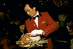 SPARKS Charity Ball fund raising at the London Hilton Hotel England Chinese part time casual work clearing away the plates at the end of a meal. 1990s.