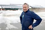 Foto: VidiPhoto<br /> <br /> GROESBEEK – Portret van melkveehouder Martien Nillesen voor zijn zonnepanelen.