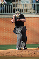 Home plate umpire Scott Graham makes a strike call during the Conference USA baseball game between the Florida Atlantic Owls and the Charlotte 49ers at Hayes Stadium on March 14, 2015 in Charlotte, North Carolina.  The Owls defeated the 49ers 8-3 in game one of a double header.  (Brian Westerholt/Four Seam Images)