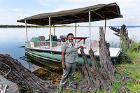 Botswana, Kasane, Chobe National Park, Chobe Game Lodge. All women guides with their safari river boats on the Chobe River.