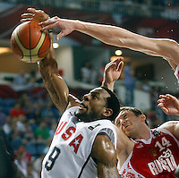 Andre IGUODALA (USA) jumps for the ball with Evgeny VORONOV (Russia)  during the quarter-final World championship basketball match against Russia in Istanbul, USA-Russia, Turkey on Thursday, Sep. 09, 2010..