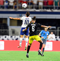 DALLAS, TX - JULY 25: Cristian Roldan #10 of the United States attempts to head the ball over Liam Moore #6 of Jamaica during a game between Jamaica and USMNT at AT&T Stadium on July 25, 2021 in Dallas, Texas.