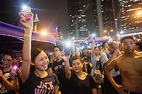 Pro-democracy protesters are seen in front of the Hong Kong government offices on day three of the mass civil disobedience campaign Occupy Central, Hong Kong, China, 30 September 2014.