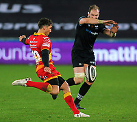 (L-R) Gavin Henson of the Dragons kick the ball over Alwyn Wyn Jones of the Ospreys during the Guinness PRO14 match between Ospreys and Dragons at The Liberty Stadium, Swansea, Wales, UK. Friday 27 October 2017